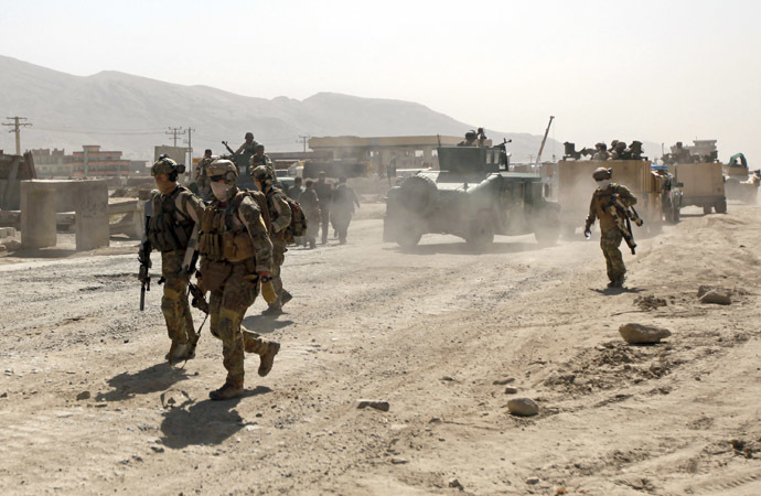 Members of the NATO-led International Security Assistance Force (ISAF) arrive at the site of an attack in Kabul June 10, 2013 (Reuters/Mohammad Ismail)