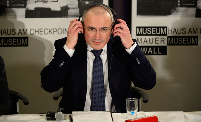 Former Russian oil tycoon and Kremlin critic Mikhail Khodorkovsky speaks at a press conference at the Wall Museum at Checkpoint Charlie on December 22, 2013 in Berlin.( AFP Photo / John Macdougall)