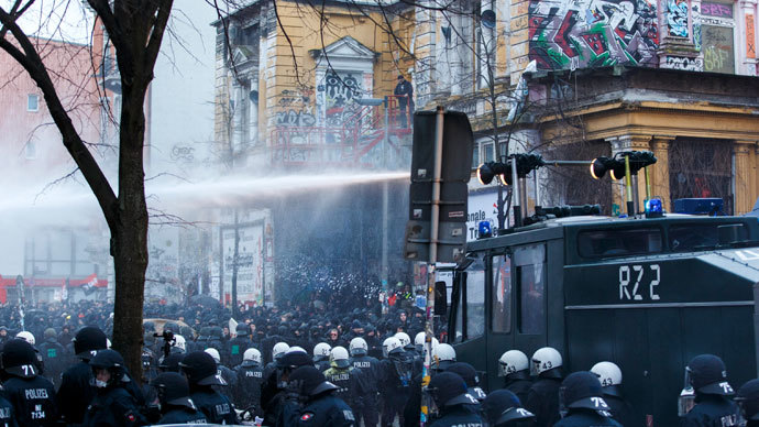 German police use water cannons to clear a street following clashes in front of the 'Rote Flora' cultural centre during a demonstration in Hamburg, December 21, 2013.(Reuters / Morris Mac Matzen)