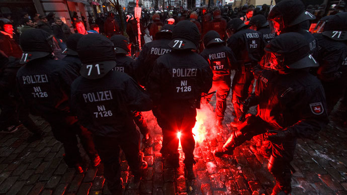 German police is attacked with fireworks during clashes in front of the 'Rote Flora' cultural centre during a demonstration in Hamburg, December 21, 2013. (Reuters / Morris Mac Matzen)
