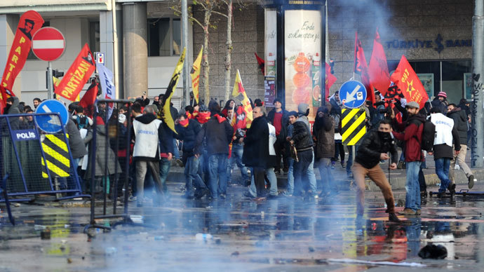 Protestors throw stones as riot police use tear gas and water cannon during a demonstration on December 22, 2013 in the Asian side of Istanbul.(AFP Photo / Ozan Kose)