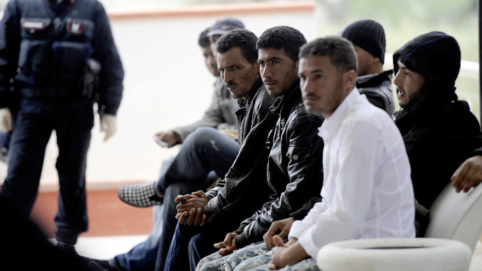 Immigrants sew mouths shut to demand release from migrant center in Italy
