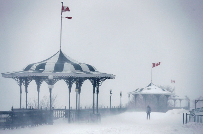 A pedestrian walks on the Terrasse Dufferin during a snowstorm in Quebec City December 22, 2013. (Reuters/Mathieu Belanger)