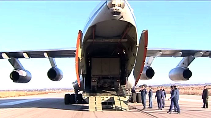 Russian military armored trucks being unloaded in Syria after an airlift. RT video still.