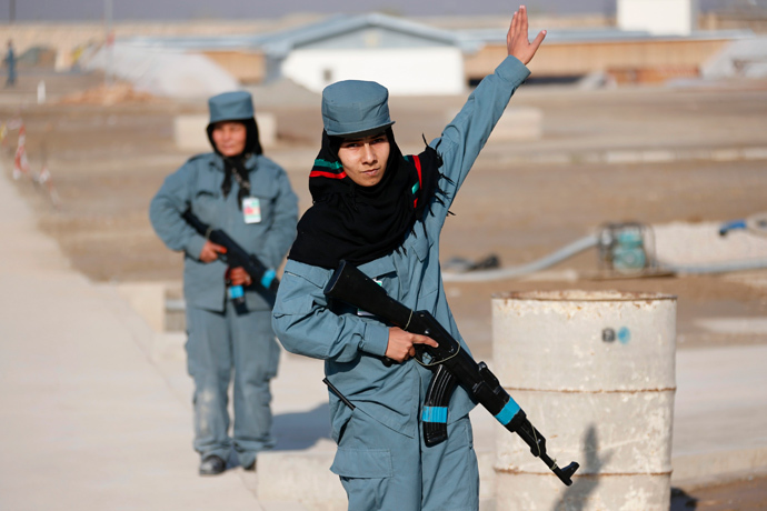 A female Afghan National Police (ANP) officer gives instructions during a patrol training session, at a training centre near the German Bundeswehr army camp in Kunduz, northern Afghanistan December 3, 2012. (Reuters / Fabrizio Bensch)