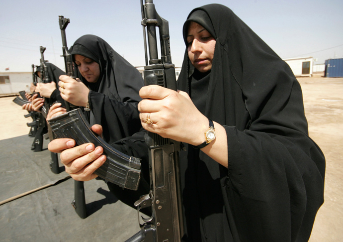 Policewomen practise assembling and disassembling a Kalashnikov automatic rifle during a training course at a police academy in Kerbala, 80 km (50 miles) southwest of Baghdad April 27, 2011. (Reuters / Mushtaq Muhammed)