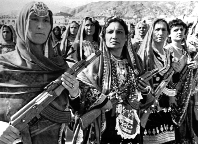 Afghan women carry Soviet AK-47's during a parade of village defense forces in 1988. (Reuters / Richard Ellis)