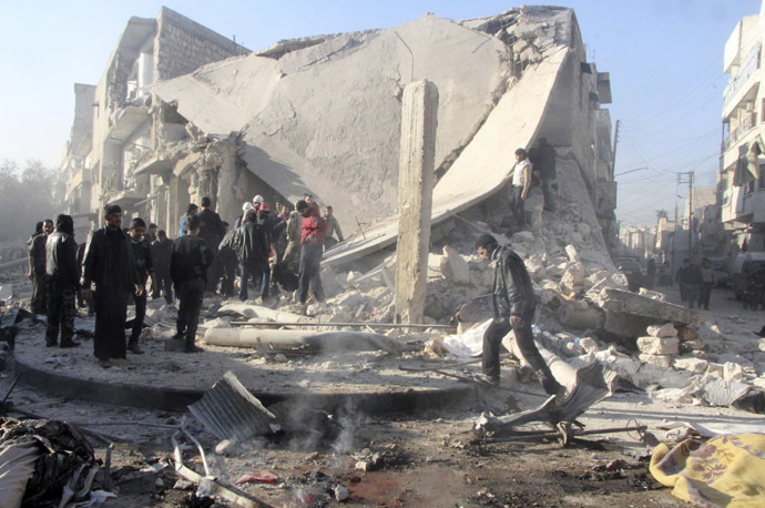 People inspect a site damaged by what activists said was an air raid by forces loyal to Syrian President Bashar Al-Assad, in Aleppo's al-Marja district December 23, 2013. (Reuters/Saad AboBrahim)