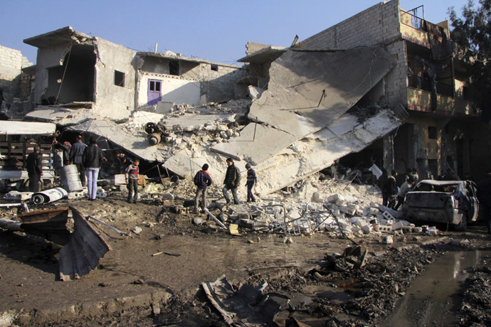 Residents inspect the damage at a site after what activists said was an air raid by forces loyal to Syrian President Bashar Al-Assad, at Masaken Hanano in Aleppo, December 22, 2013. (Reuters/Saad AboBrahim)