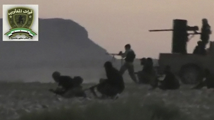 """Syrian rebels from the """"Maghawir of Baba Amer"""" and """"Baba Amer Revolutionaries"""" brigades exchange gunfire with Syrian government forces at a checkpoint in Maaloula, a suburb of Damascus, in this image taken from a September 4, 2013 video footage obtained from a social media website. (Reuters)"""