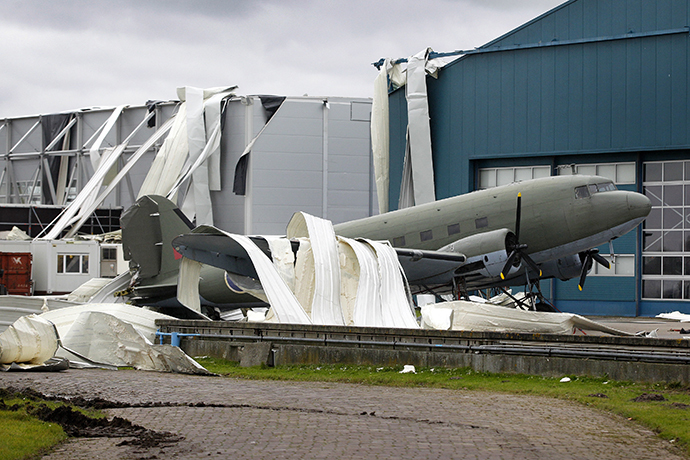 Parts of the roof of the Theatre Hangar are seen on the Dakota airplane after the roof was partially blown away by strong winds at the former airfield in Valkenburg on December 24, 2013. (AFP Photo / Bas Czerwinski)
