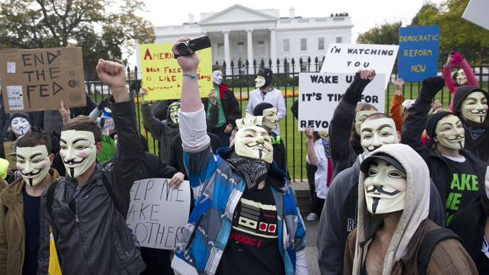 Demonstrators, including supporters of the group Anonymous, march in a protest against corrupt governments and corporations in front of the White House in Washington, DC, November 5, 2013 (AFP Photo / Saul Loeb)