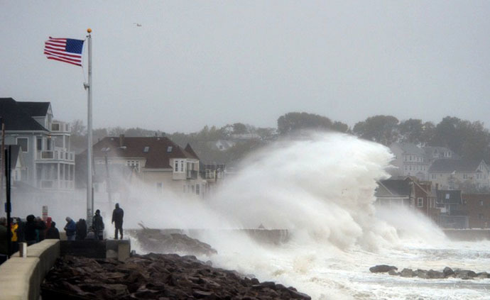 Waves crash over Winthrop Shore Drive as Hurricane Sandy comes up the coast on October 29, 2012 in Winthrop, Massachusetts. (AFP Photo / Darren Mccollester)