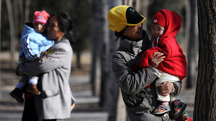 China eases notorious one-child policy, abolishes labor camps