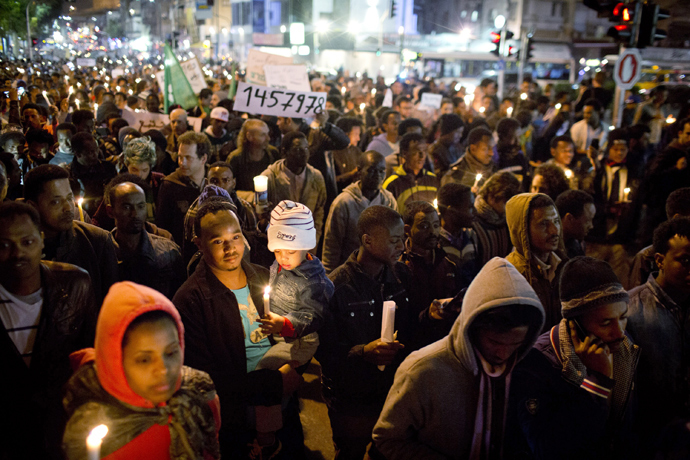 Several thousand African asylum seekers who entered Israel illegally via Egypt staged a peaceful protest in Tel Aviv on December 28 2013 (AFP Photo / Oren Ziv)