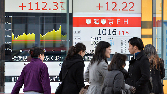 Nikkei climbs 57% in 2013, biggest rise in 41 years
