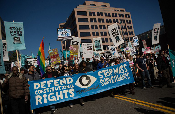 Protesters march through downtown Washington D.C. during the Stop Watching Us Rally protesting surveillance by the U.S. National Security Agency, on October 26, 2013, in front of the U.S. Capitol building in Washington, D.C. (AFP Photo / Allison Shelley)