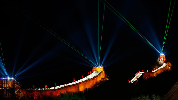 Light and laser illuminate the Great Wall of China to celebrate the new year before a new year countdown event at the Badaling section of the Great Wall, in Beijing December 31, 2013.(Reuters / Kim Kyung-Hoon )