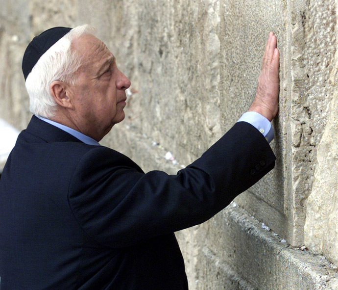 Prime Minister elect Ariel Sharon touches the stones of the Western Wall, also known as the Wailing Wall, as he prays while visiting Judiasm's holiest site in Jerusalem's Old City February 7, 2001, the morning after being elected as Israel's next prime minister. (Reuters)