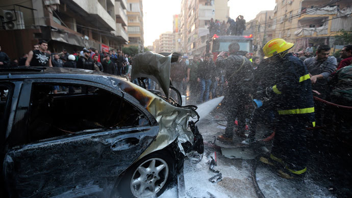 A firefighter extinguishes a fire on a car at the site of an explosion in Beirut's southern suburbs January 2, 2014.(Reuters / Hasan Shaaban)