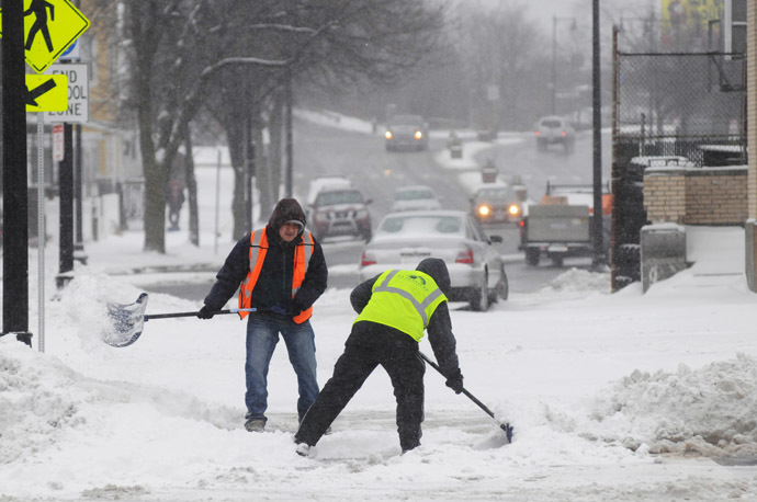 City workers shovel snow from in front of the Orient Heights T Station on Bennington Street January 2, 2014 in East Boston, Massachusetts. (Darren McCollester/Getty Images/AFP)