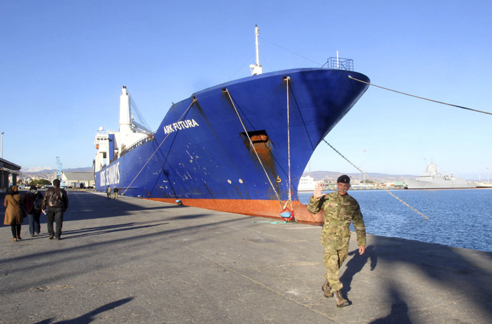One of two cargo ships intended to take part in a Danish-Norwegian mission to transport chemical agents out of Syria docks in Limassol, December 14, 2013. (Reuters/Andreas Manolis)