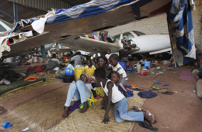 Displaced refugees are seen in a camp in an airport in Bangui December 15, 2013. (Reuters/Emmanuel Braun)