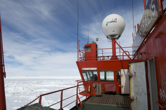 This photo provided by Fairfax Media Pool and released by the Australian Antarctic Division on January 2, 2014 shows the Chinese Antarctic vessel Xue Long (back L-in far distance) from the bridge of the Aurora Australis ship off Antarctica, both in the frozen waters to help rescue a nearby Russian research ship (not pictured). (AFP Photo / Jessica Fitzpatrick)