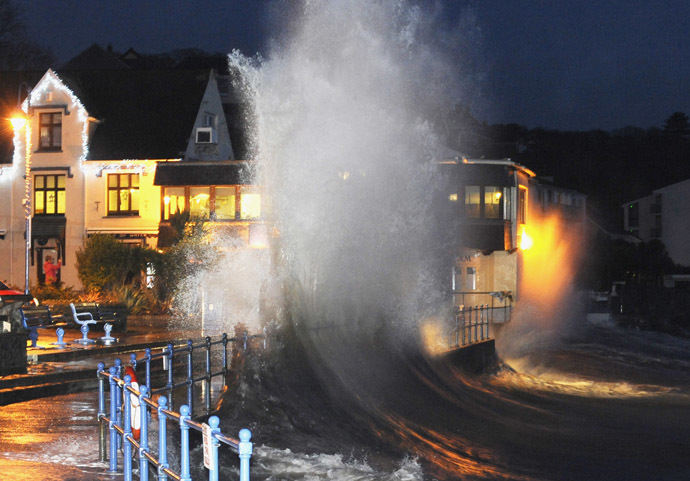 Waves crash over the promenade at hightide in Saundersfoot, in west Wales January 3, 2014. (Reuters/Rebecca Naden)