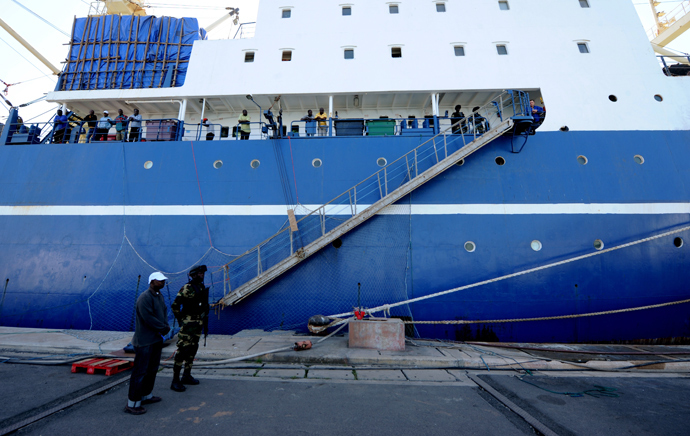 "Russian trawler ""Oleg Naydenov"" is moored under guard in Dakar on January 5, 2014. (AFP Photo / Seyllou)"