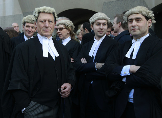 Trial lawyers demonstrate the Old Bailey courthouse in London January 6, 2014. (Reuters/Luke MacGregor)