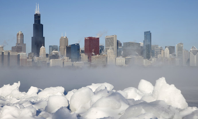 The Chicago skyline is seen beyond the arctic sea smoke rising off Lake Michigan in Chicago, Illinois, January 6, 2014. (Reuters/Jim Young)