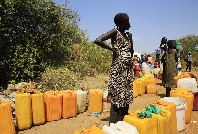 A woman displaced by recent fighting in South Sudan waits to collect water at a makeshift camp in the United Nations Mission in Sudan (UNAMIS) facility in Jabel, on the outskirts of capital Juba December 23, 2013. (Reuters/James Akena)