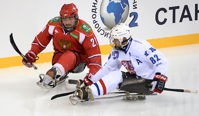 Russia's Yevgeny Petrov, left, and Czech Republic's Zdenek Habl in the 3rd place match between the national teams of Russia and the Czech Republic, the Four Nations Tournament on September 1, 2013. (RIA Novosti / Mihail Mokrushin)