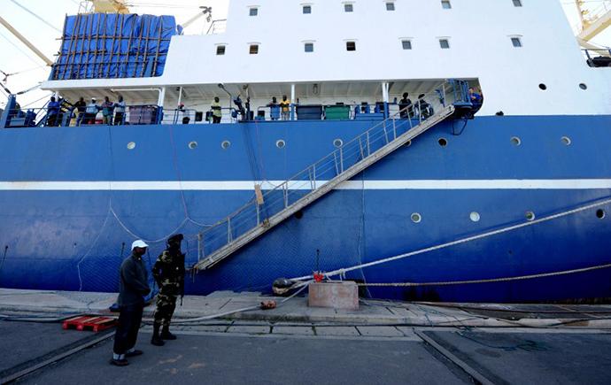 "A Russian trawler ""Oleg Naпdenov"" ,is moored under guard in Dakar on January 5, 2014. (AFP Photo / Seyllou)"