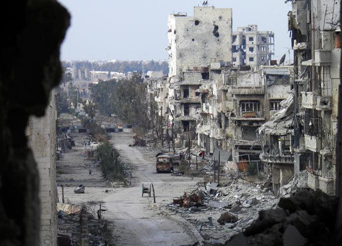 Damaged buildings line a deserted street in the besieged area of Homs.(Reuters / Thaer Al Khalidiya)
