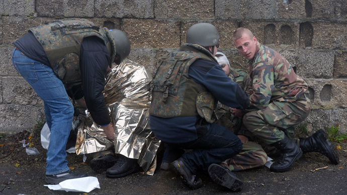 Apprentice chemical weapons inspectors of the United Nations and extras take part in an exercise during the education of OPCW (Organisation for the Prohibition of Chemical Weapons) inspectors at the German army Bundeswehr training area in Wildfelecken, southern Germany (AFP Photo)