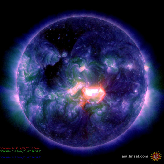 This January 7, 2014 handout image captured by NASA's Solar Dynamics Observatory shows a false-color composite image from a blast of activity originating from an active sunspot region at the center of the sun's disk (AFP Photo)