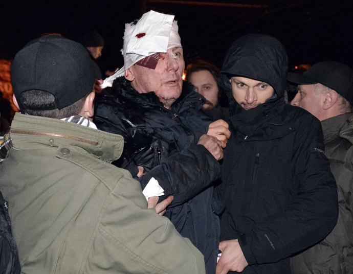 Former Ukrainian Interior and opposition leader Minister Yuriy Lutsenko receives medical help after clashes with riot police near a court in Kiev January 10, 2014. (Reuters)