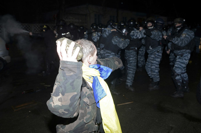 An opposition activist clashes with riot police during a rally near a court in Kiev January 10, 2014. (Reuters/Maks Levin)