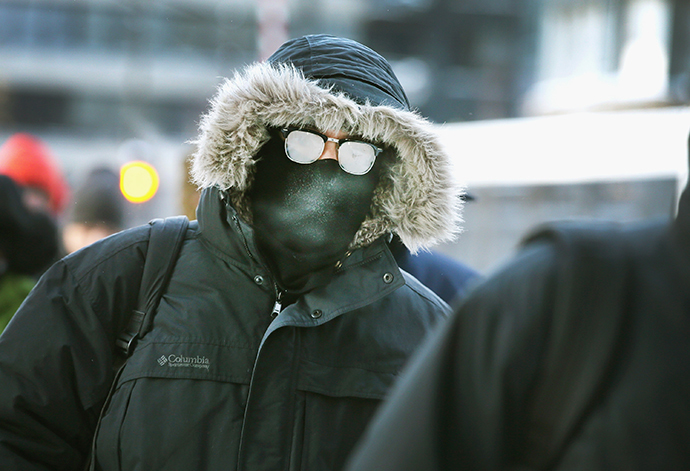 Commuters make a sub-zero trek to offices in the Loop on January 6, 2014 in Chicago, Illinois. (AFP Photo / Getty Images / Scott Olson)