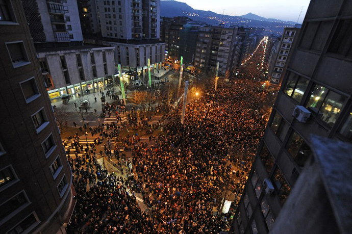 People march during a demonstration called by several Basque political parties, trade unions and social groups in the northern Spanish Basque city of Bilbao on January 11, 2014. (AFP Photo / Rafa Rivas)