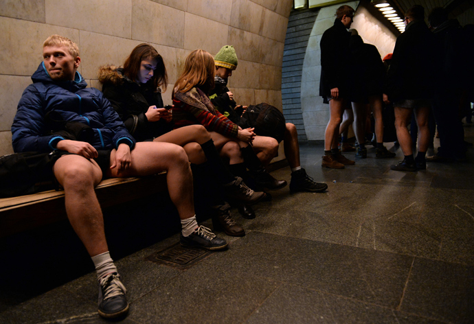 People in underwear wait for a train in the Kiev subway as they take part in the 2014 No Pants Subway Ride on January 12, 2014 (AFP Photo / Vasily Maximov)