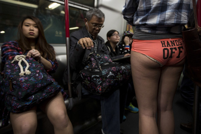 "A woman takes part in the annual ""No Pants Subway Ride"" on a Mass Transit Railway (MTR) train in Hong Kong January 12,2014. (Reuters/Tyrone Siu)"