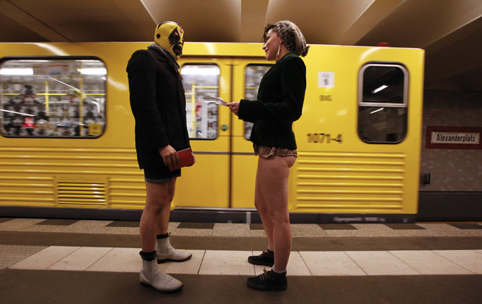 "Passengers without their pants talk next to a subway train during the ""No Pants Subway Ride"" event at Alexanderplatz subway station in Berlin January 12, 2014. (Reuters/Fabrizio Bensch)"