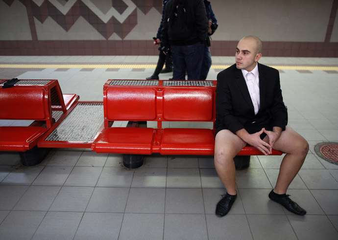 "A passenger without his pants waits for a subway train during the ""No Pants Subway Ride"" event in Sofia January 12, 2014. (Reuters/Stoyan Nenov)"
