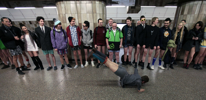 "Passengers, not wearing pants, perform as they wait for a subway train during the ""No Pants Subway Ride"" in Prague January 12, 2014. (Reuters/David W Cerny)"