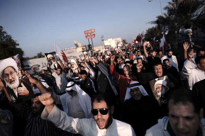 Bahraini protestors shout anti-regime slogans during an anti-government protest in the village of Shakhora, west of Manama, on January 3, 2014. (AFP Photo / Mohammed Al-Shaikh)