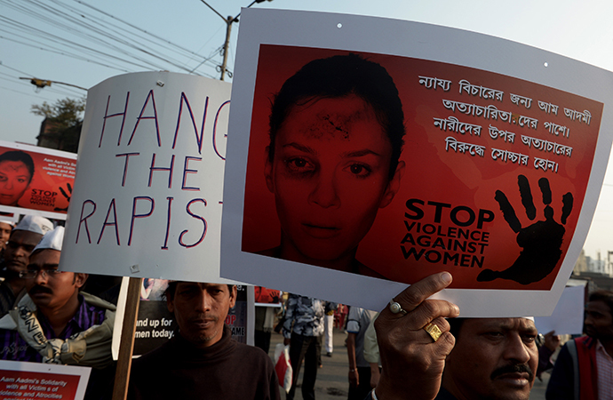 Indian Aam Admi Party (AAP) activists hold posters during a rally as they protest against the gangrape and murder of a teenager in Kolkata on January 5, 2014. (AFP Photo / Dibyangshu Sarkar)