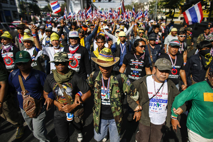 Anti-government protesters link their arms as they march during a rally in central Bangkok January 17, 2014. (Reuters/Athit Perawongmetha)